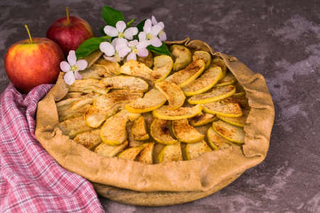 The apple and cinnamon pie is decorated with apple blossom.