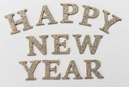 Inscription Happy New Year in silver letters on a white background. Stock fotó