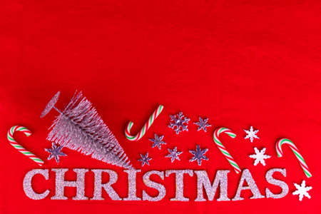 Red Christmas background with inscription Christmas and decorations. Copy space. Stock fotó