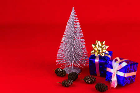Christmas composition on a red background.Copy space. Stock fotó