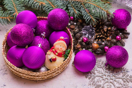 Basket with Christmas decorations. Concept of preparation for Christmas. Stock fotó