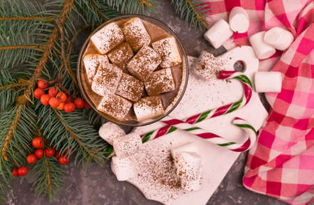 Cup with Christmas cocoa with marshmallows on the background of Christmas decorations. Flat lay. Stock fotó