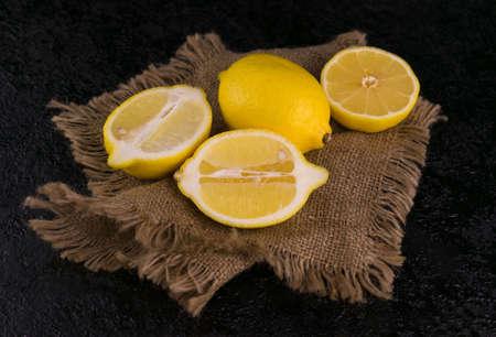 Lemons cut on a black background. Top view.
