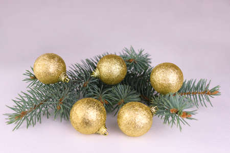 pine branch with golden balls on a white background. Christmas background copy space.