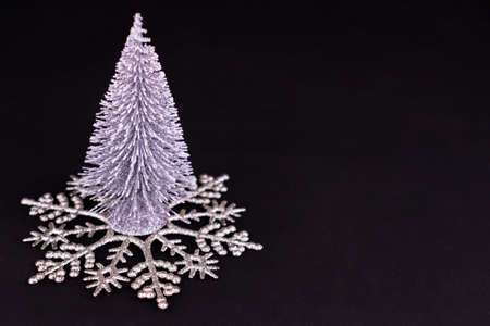 Small Silver Christmas Tree Large Snowflake Black Background Copy Space