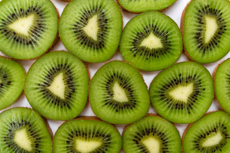 Kiwi slices background. Top view.