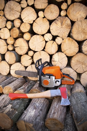 Ax in stump. Ax ready for cutting timber. Woodworking tool. Lumberjack ax in wood, chopping timber.