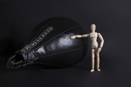 Punching bag and man. Black punching bag. Reklamní fotografie