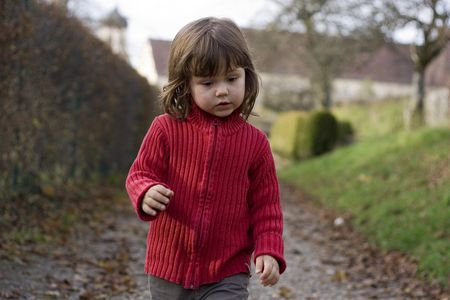 little girl in red sweter in the park Stock Photo - 756143