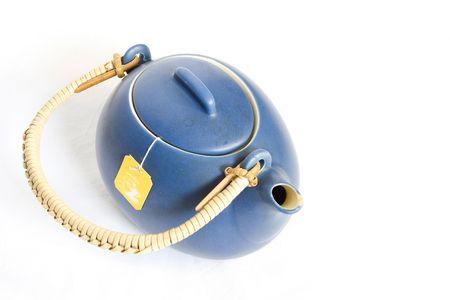 isolated photo of a blue tea kettle photo