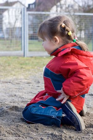 little girl playing at the playground in the sand Stock Photo - 781880