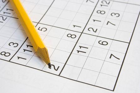 Sudoku puzzle and yellow pencil. lazy sunday Stock Photo