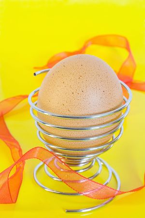 Easter eggs in the eggcup. on yellow