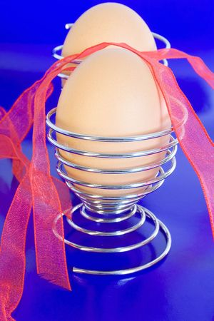 eggcup: Easter eggs in the eggcup. on blue