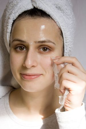 Portrait of young woman with beauty mask Stock Photo