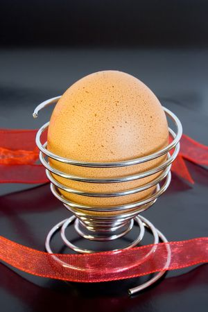 eggcup: Easter eggs in the eggcup. on black