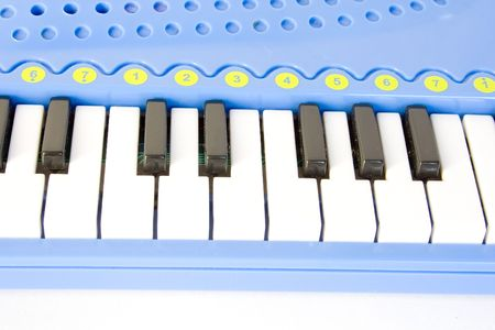 acoustically: blue childs piano isolated on white