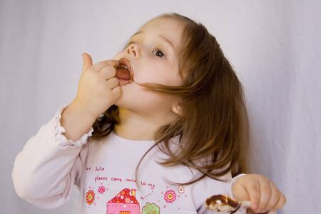 little girl eating the chocolate Stock Photo