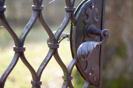 Photo of an old gate with beautiful handle Stock Photo