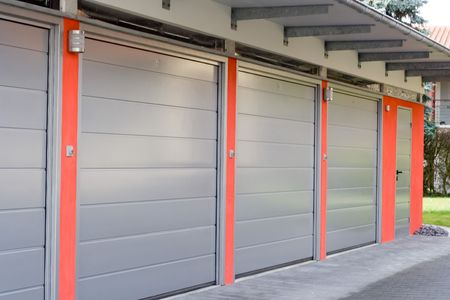 grey garage doors and red walls Stock Photo