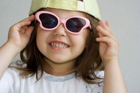 portrait of little girl wearing sunglasses