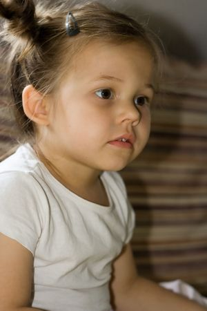 lost in thought: portrait of cute, little girl lost in thought