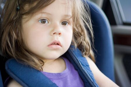 portrait of little girl sitting in the car
