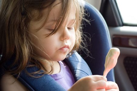 photo of little girl sitting in the car