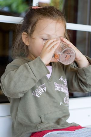 little thirsty girl with glass of water