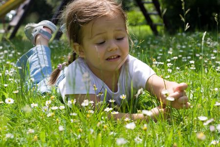 little girl on the meadow. summer time. Stock Photo
