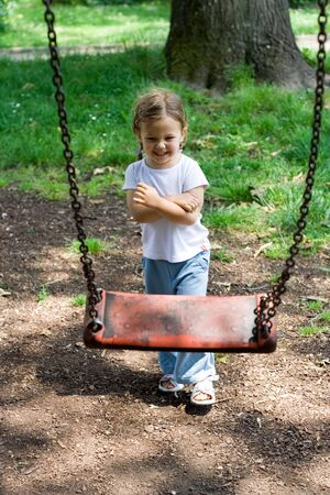 the little girl playing at the playground