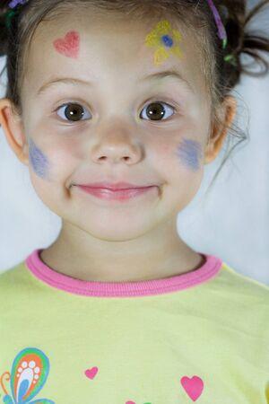 cara pintada: retrato de la peque�a muchacha con la cara pintada Foto de archivo