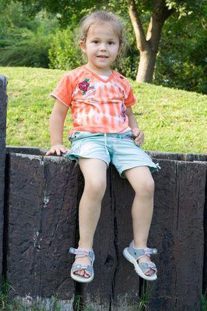 little girl having fun on the playground Stock Photo - 1365115