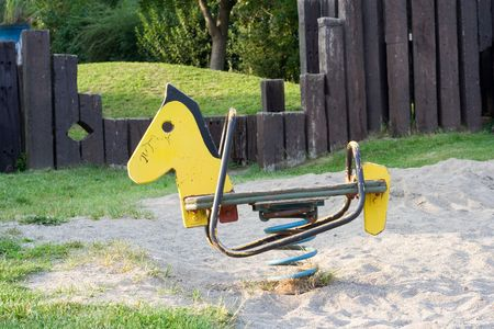 lonely toy horse standing on the playground