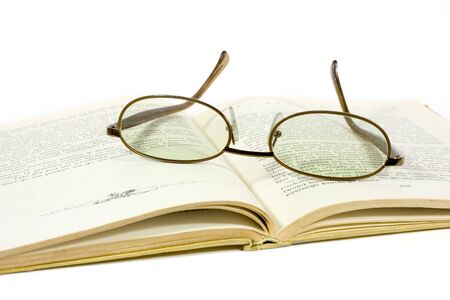 open book and eyeglasses isolated on white