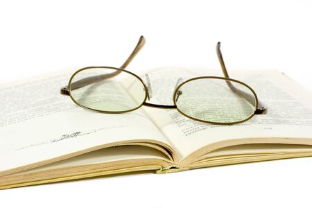 open book and eyeglasses isolated on white Stock Photo - 1367071