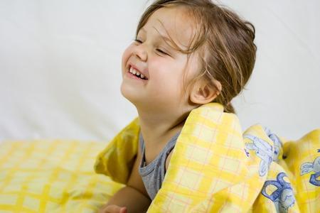 little girl lying in her bed. sleep time