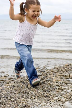 little cute girl playing at the beach.  Stock Photo - 1423918