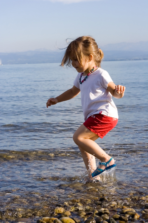 little cute girl playing at the beach.  Stock Photo