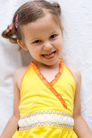 girl tongue: little, cute girl wearing yellow summer dress