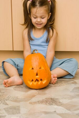 little, cute girl with a halloween lantern Stock Photo
