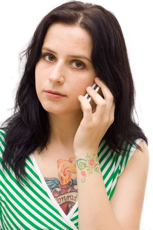 young tattooed woman on the phone. isolated. Stock Photo - 1897879