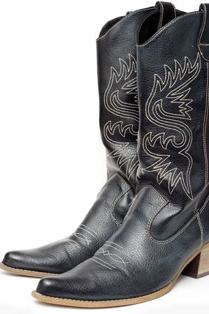 Western cowboy black boots on white background