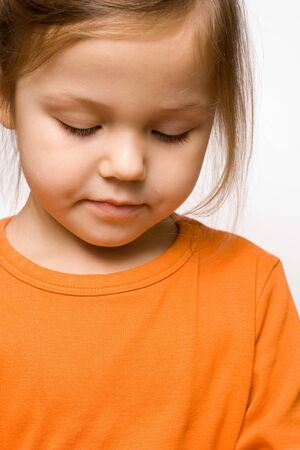 little cute girl wearing orange shirt isolated on white