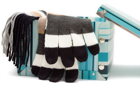 gloves and scarf in the box isolated on white