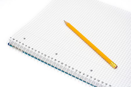 notepad and yellow pencil isolated on white photo