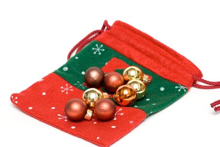 heap snow: christmas glass balls and sock isolated on white Stock Photo