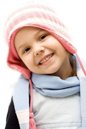 little cute girl wearing a  cap and a scarf
