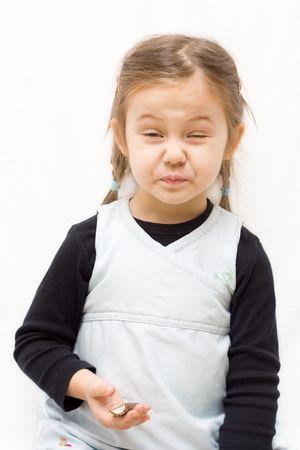 チョコレート ・ キャンディを食べて少しかわいい女の子。 写真素材