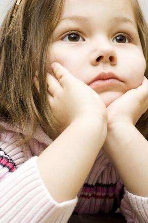 portrait of a little cute girl watching tv.  photo